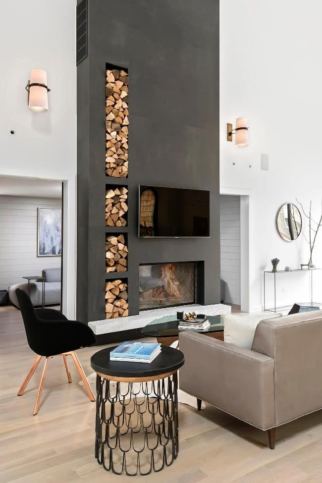 Стильный камин с оригинальными нишами под дрова
