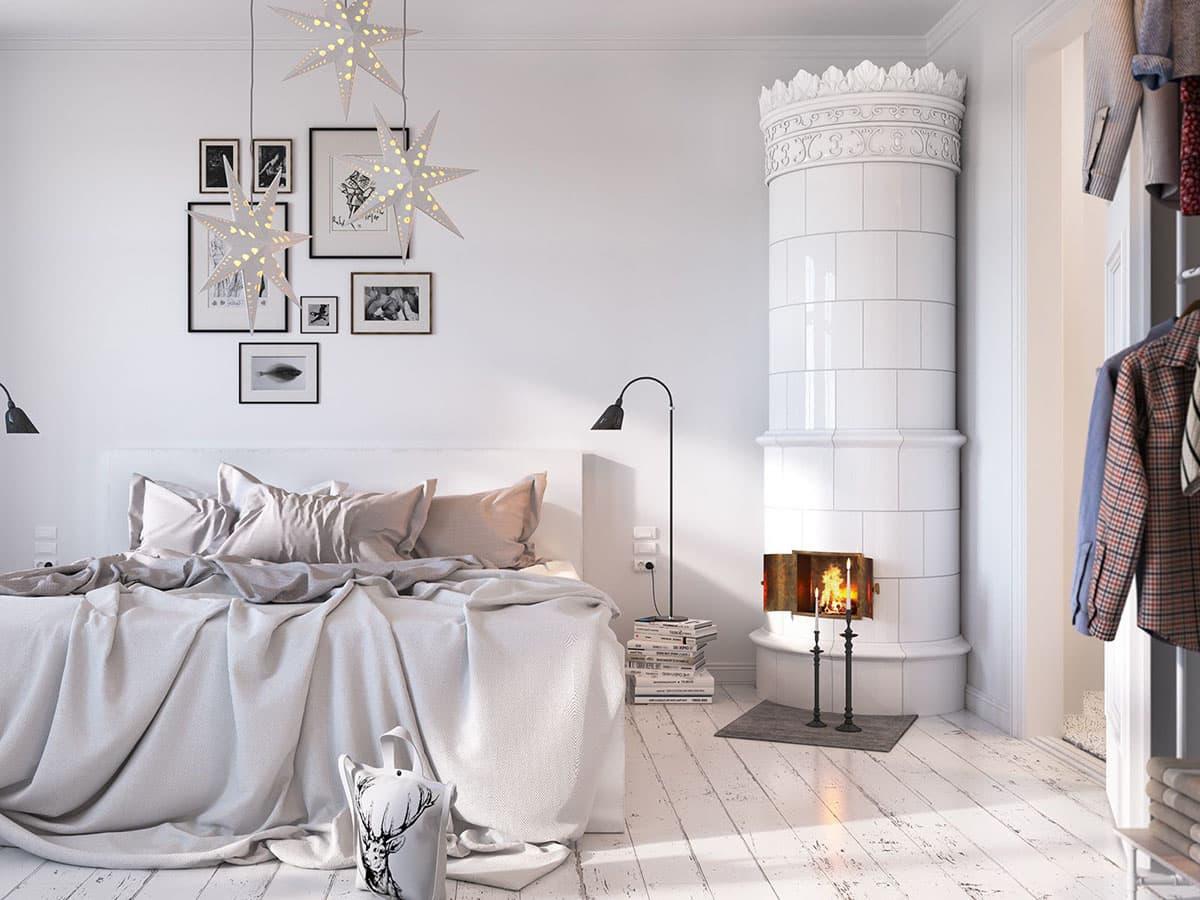Белоснежный интерьер спальни с оригинальным камином в виде старинной башни средневекового замка