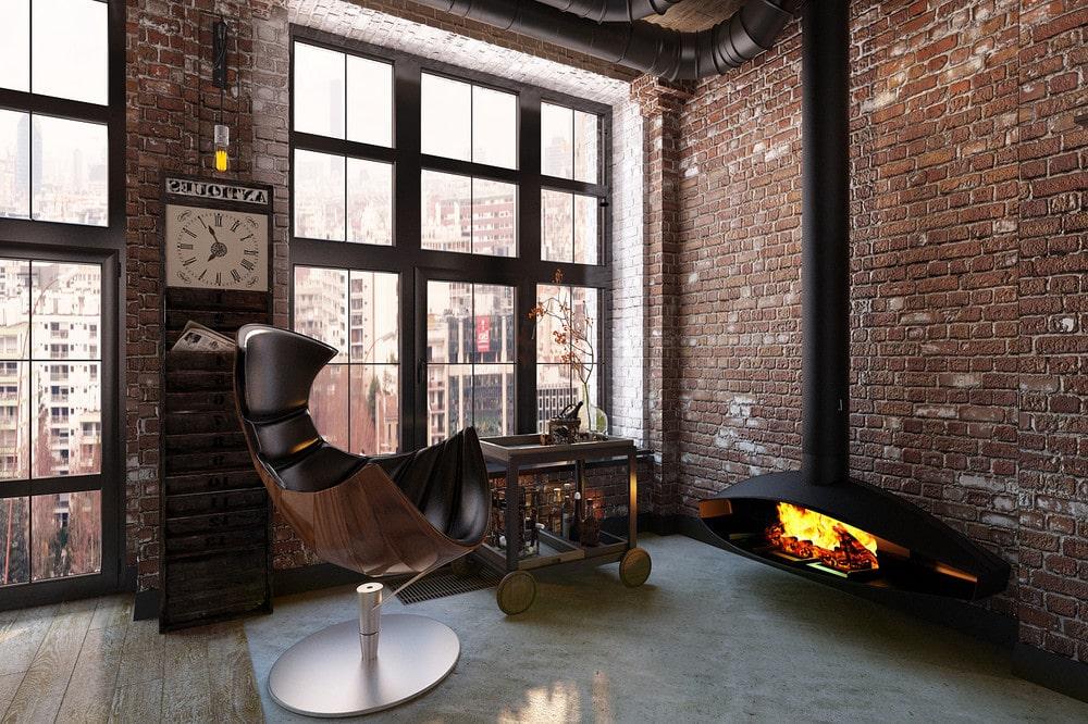 Уютное кресло у горящего камина станет любимым местом в доме