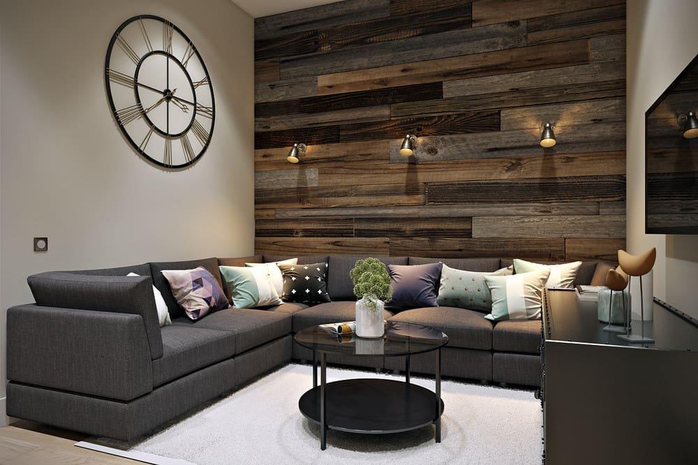 Нейтральные стены гостиной разбавит ламинат с фактурой натурального дерева