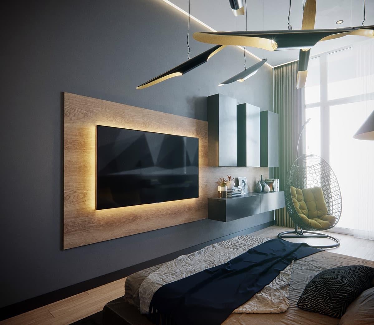 Интересным решением является выделение стены за телевизором объемным порталом из ламината