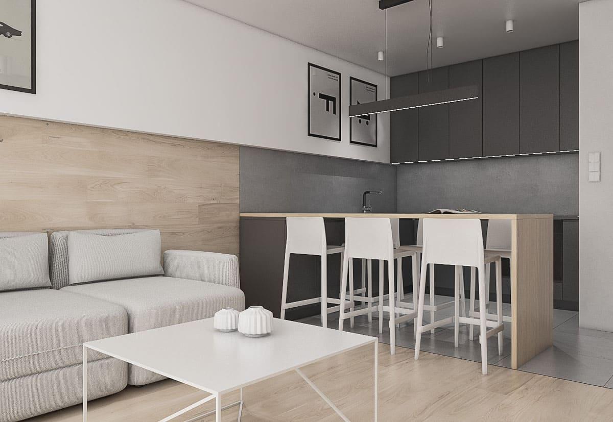 Модный и современный прием в дизайне интерьера - это уложенный ламинатом пол, который плавно переходит на стену