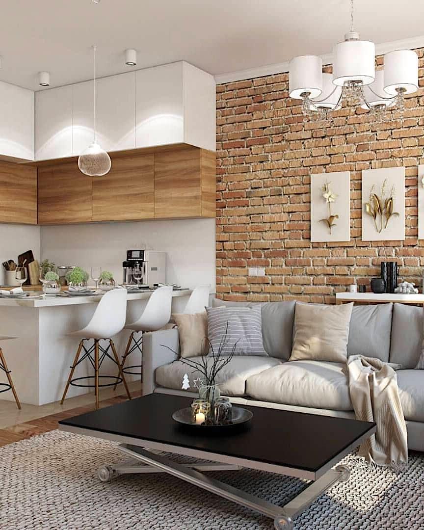 Классический лофт интерьер с акцентной кирпичной стеной, выделяющей брутальный характер индустриального стиля