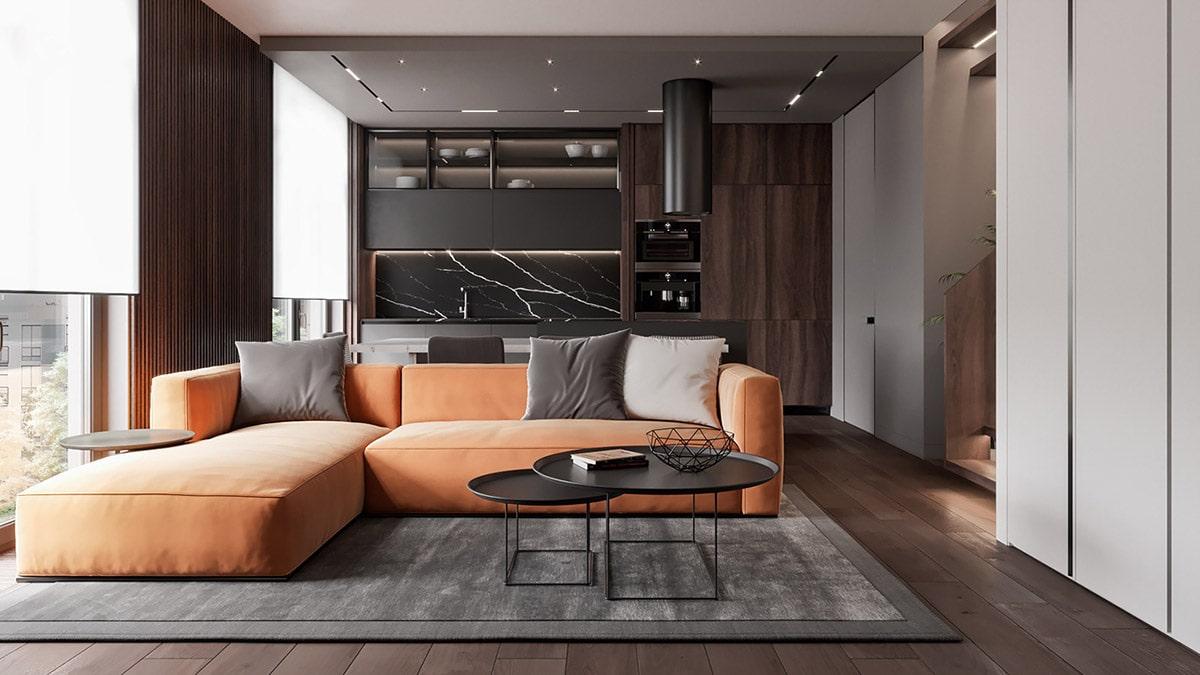 Яркий диван в интерьере квартиры-студии несет функцию зонирования