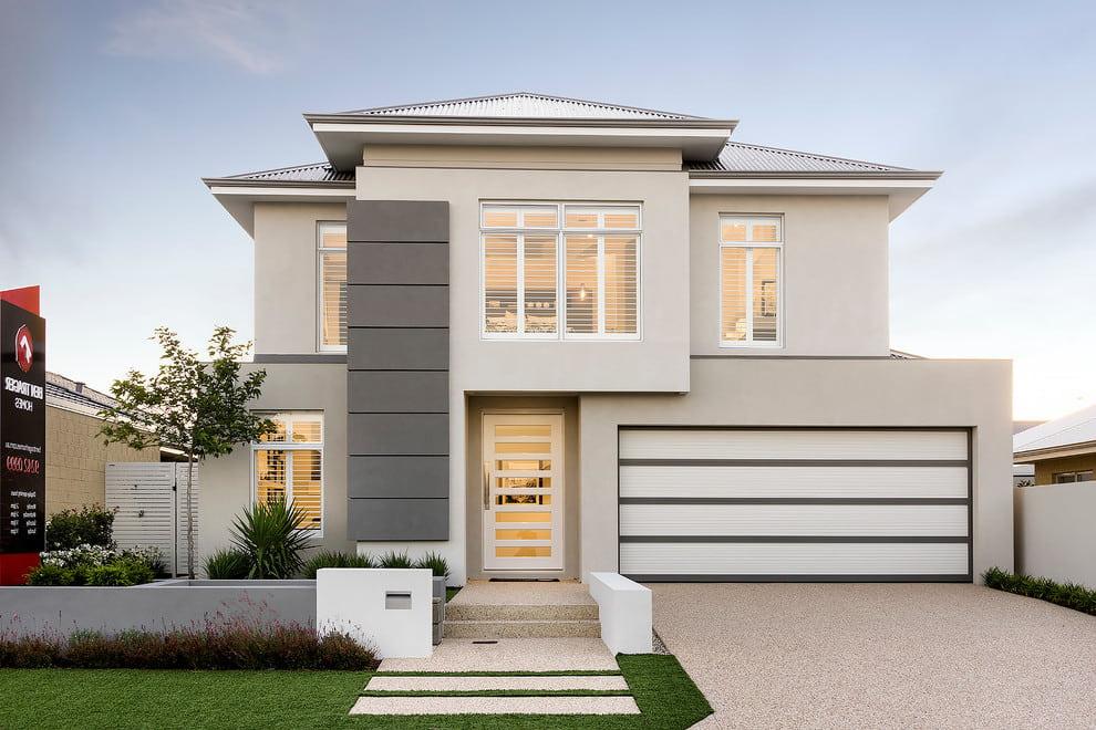 Красивый двухэтажный частный дом с пристроенным гаражом