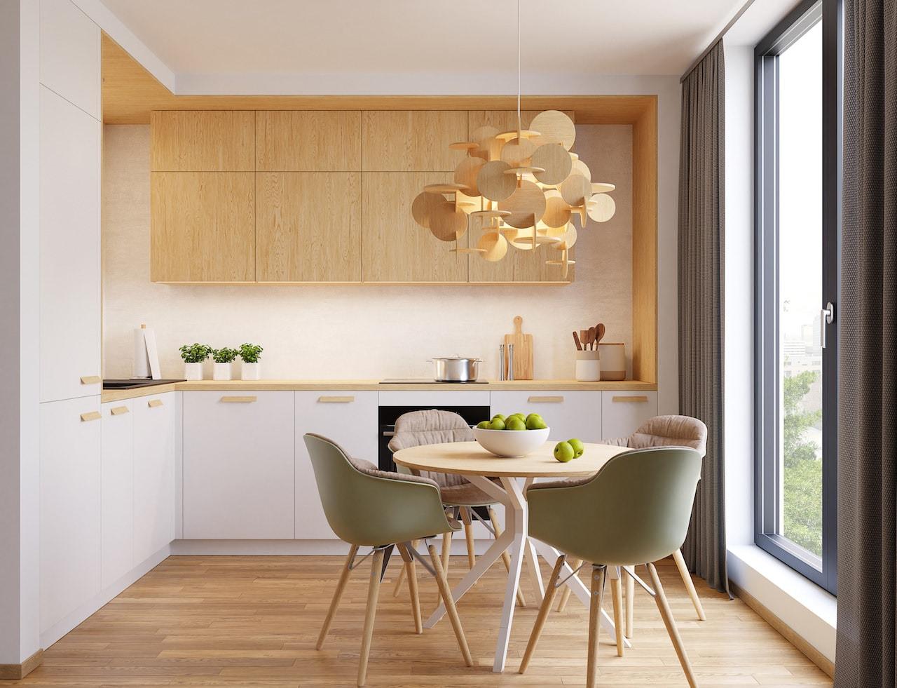В оформление белой кухни со столешницей под натуральное дерево должно входить несколько цветов, в идеале достаточно три оттенка