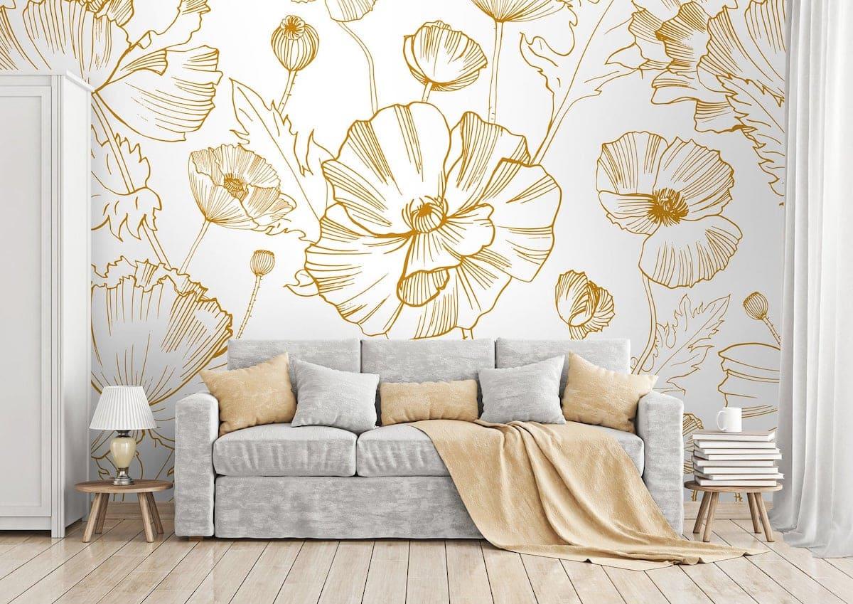 Обои с золотыми цветами на белом фоне изменят интерьер комнаты в лучшую сторону