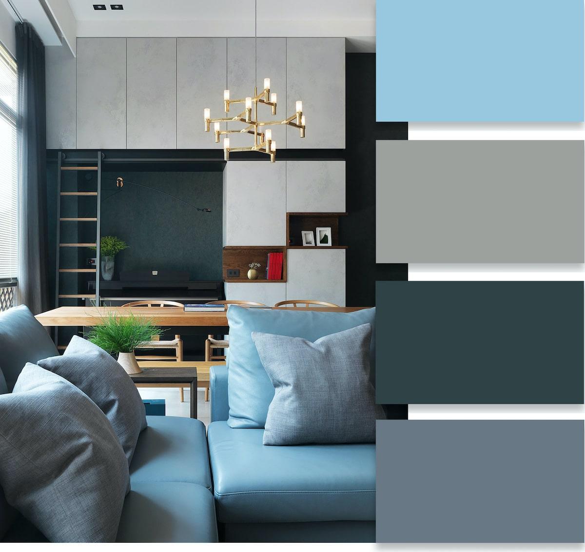 Стильный дизайн интерьера гостиной с роскошным голубым диваном