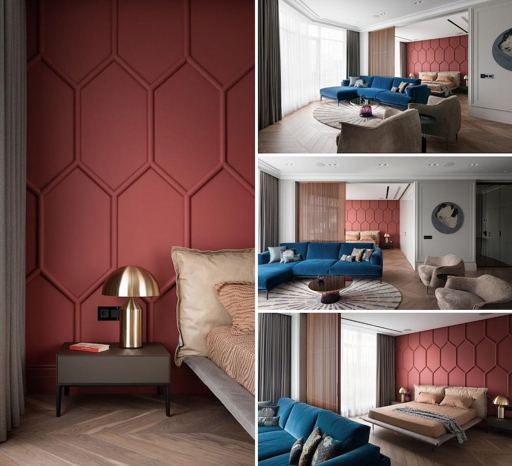 Удачное сочетание красного и синего цвета в оформлении гостиной комнаты совмещенной со спальней